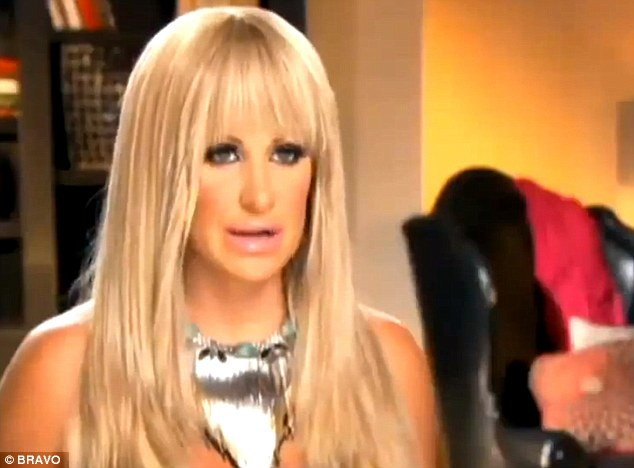 Faking it: The star wore a wig with heavy bangs for the season premiere of Real Housewives of Atlanta on Sunday