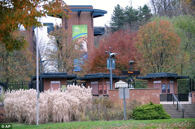 Emergency: Now closed, the Pittsburgh Zoo's entrance is seen after the young boy was killed after falling into the exhibit around noon