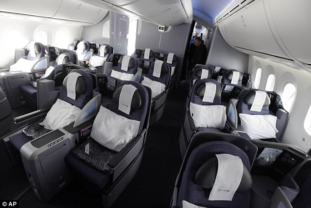 Sky's the limit! The first class cabin is seen featuring larger windows, special lighting and filtered air throughout the plane