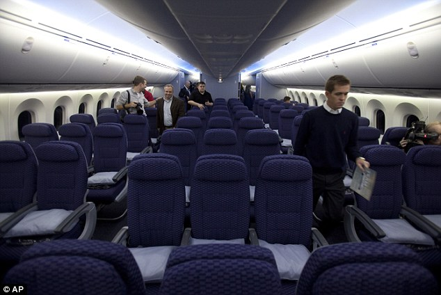 Grand tour: Members of the media tour the rest of the Boeing 787's cabin aimed to meet its passengers ultimate comfort
