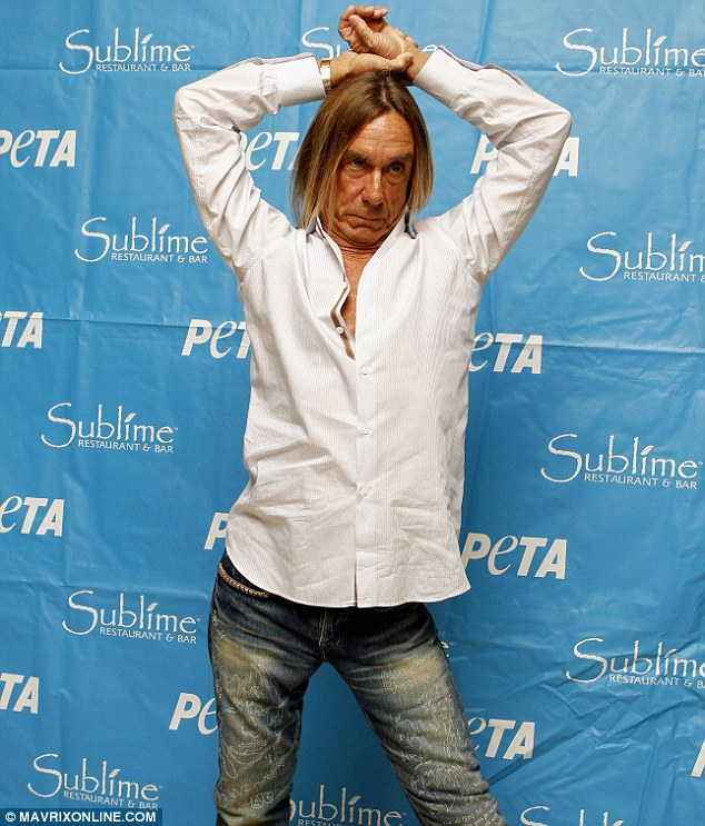 Strike a pose: Iggy Pop cast his eyes down at the cameras as he posed on the red carpet at a PETA event in Fort Lauderdale, Florida on Sunday
