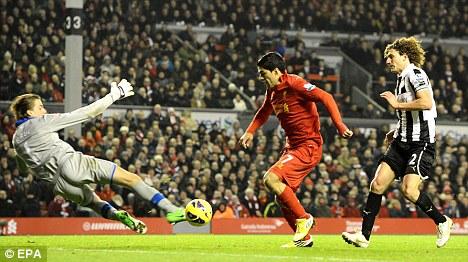 Silky: Luis Suarez glided past Newcastle keeper Tim Krul to score