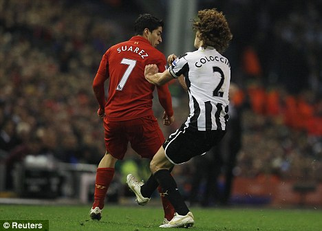 Seeing red: Fabricio Coloccini was sent off for this challenge on Suarez