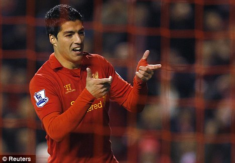 Net gain: Suarez celebrated after scoring Liverpool's equaliser at Anfield