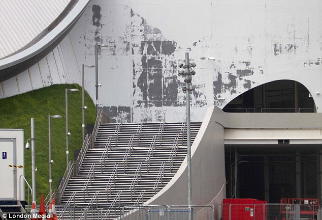 Workman have been removing paneling from the huge swimming stand piece by piece, revealing the steps climbed by spectators as they watched historic events like Tom Daley diving