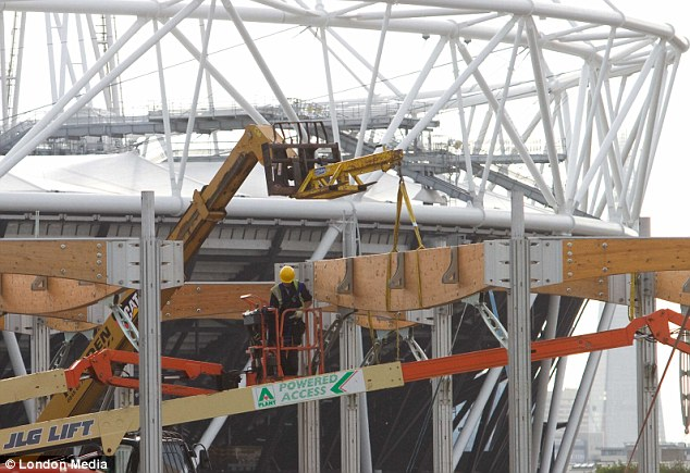 Workmen set about dismantling and adapting Olympic venues before they reopens in 2014