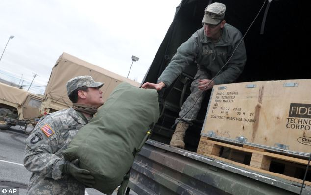 Moving out: Members of the National Guard who've been supporting the Sandy relief effort in Manhattan need to find alternative accommodation for the next few nights