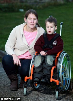 Four-year-old Samuel Horton with his mother Maria Horton at their home in Plymouth, Devon