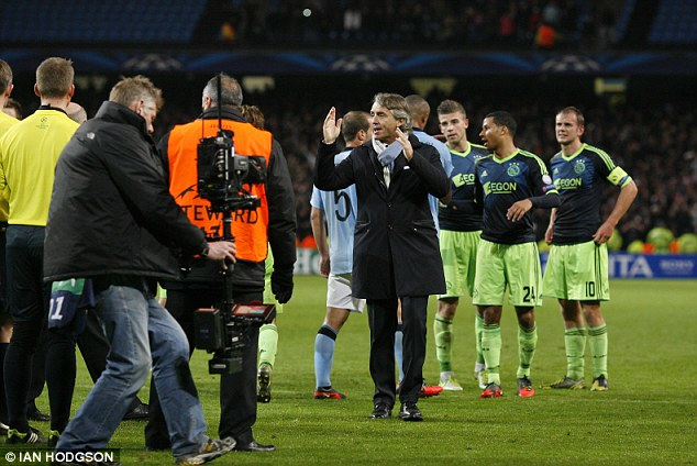 Fury: Roberto Mancini squares up to Danish referee Peter Rasmussen after the final whistle