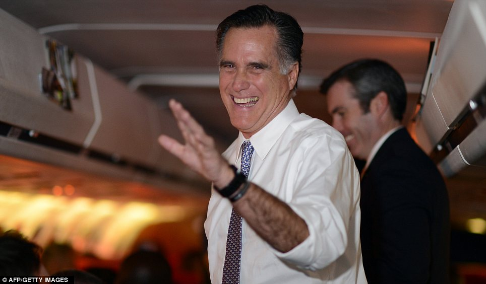 Confident? Mitt Romney takes the last flight of his presidential campaign on the way to his headquarters in Boston