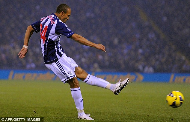 Get in: Odemwingie fired West Brom into the lead after appearing to handle the ball earlier in the move