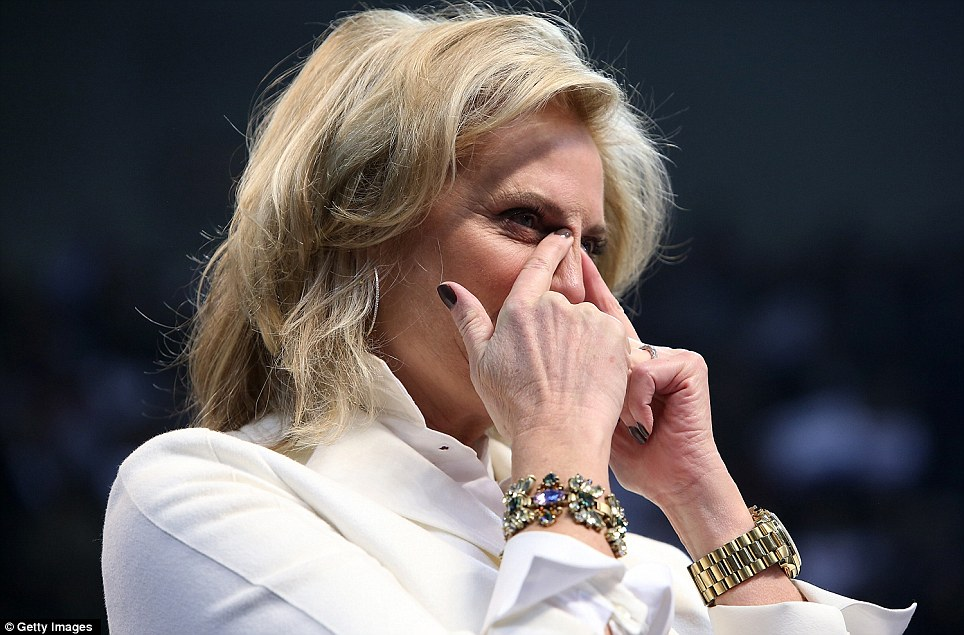 Emotions: Ann Romney wipes away tears during her husband's last campaign rally