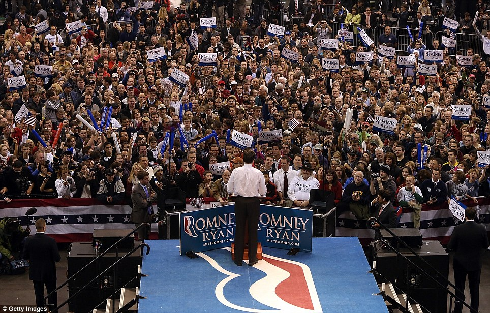 Sea of supporters: Romney speaks during his final campaign rally at the Verizon Wireless Arena in Manchester, New Hampshire