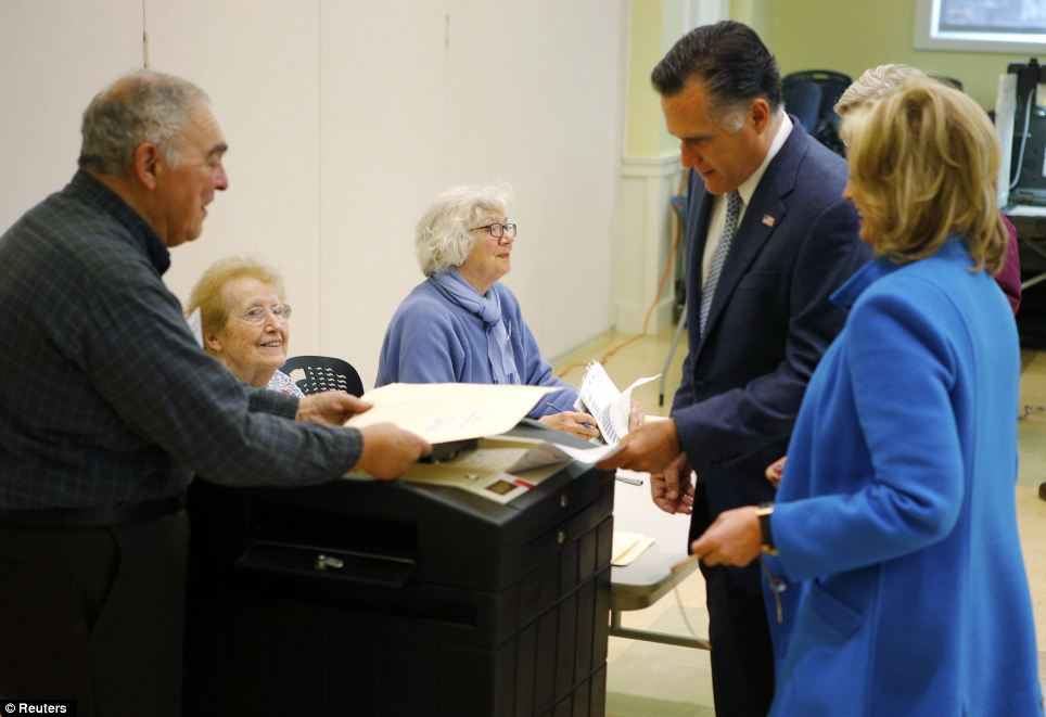 Stepping up: Romney, with his wife Ann at his side, casts his ballot for the U.S. presidential election in Belmont