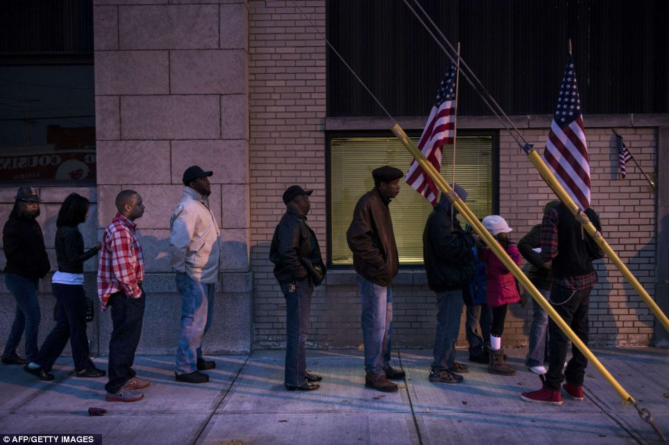 Looking to the future: Voters wait in front of the Mt. Pleasant Library in Cleveland, Ohio early on Tuesday to vote in the elections