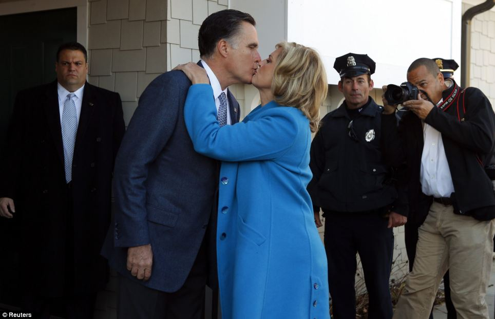Support: The Romneys share a kiss after voting in Belmont - and ahead of final campaign stops in Ohio and Pennsylvania