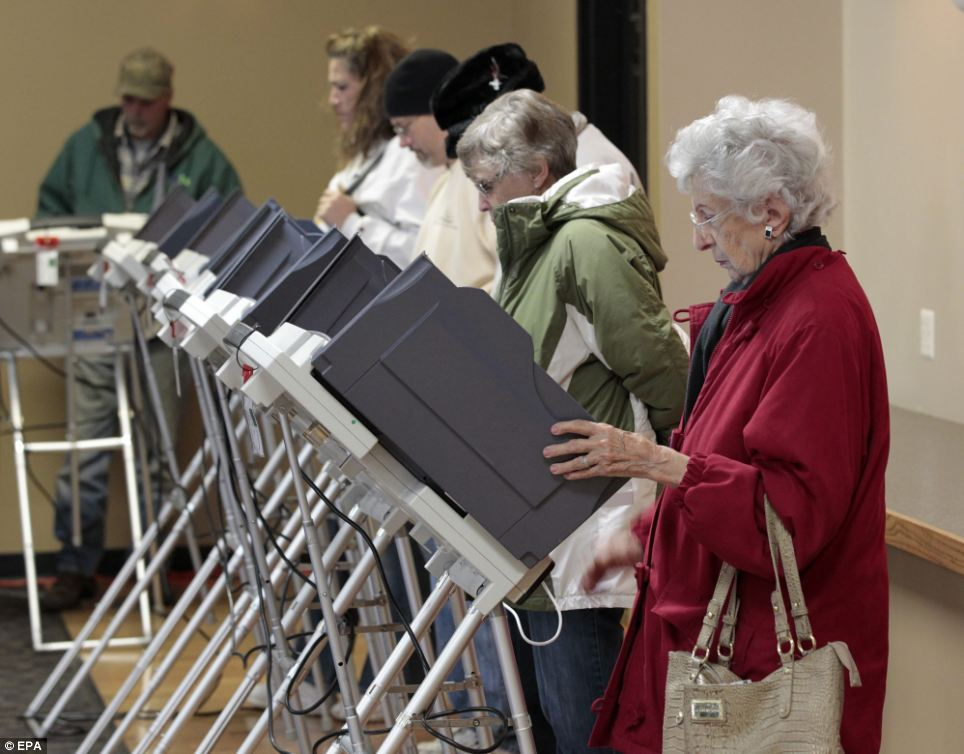 Choices: More voters gather around booths in Toledo to make their choice for the president of the United States
