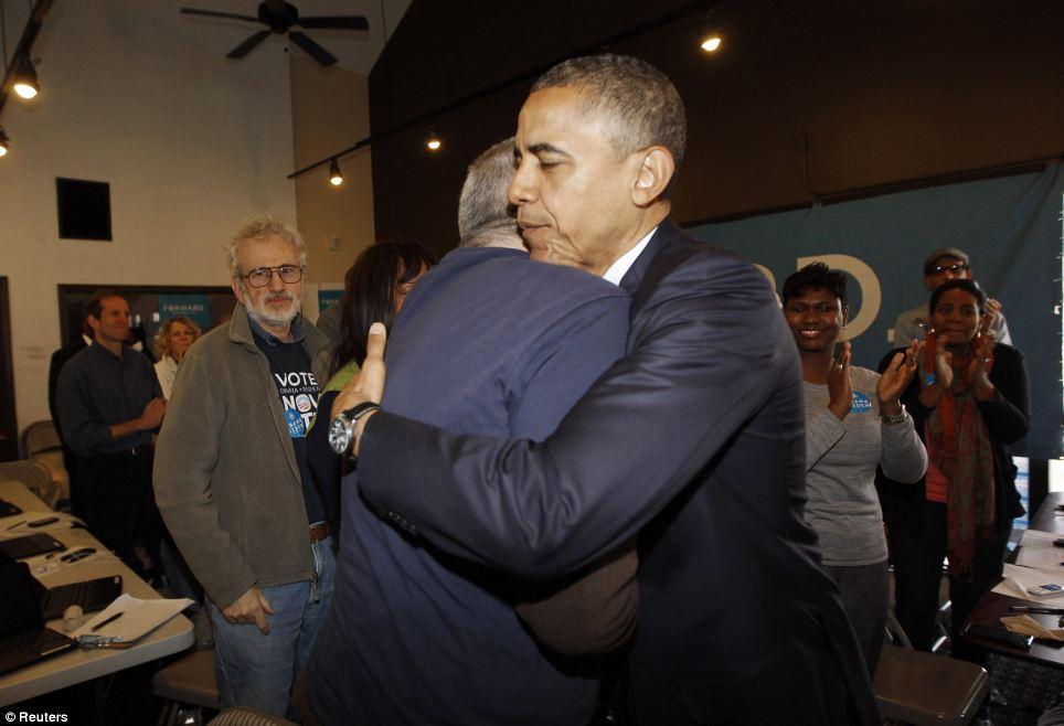Thankful: The president hugs a volunteer during his visit to a campaign field office in Chicago, near to his South Side home