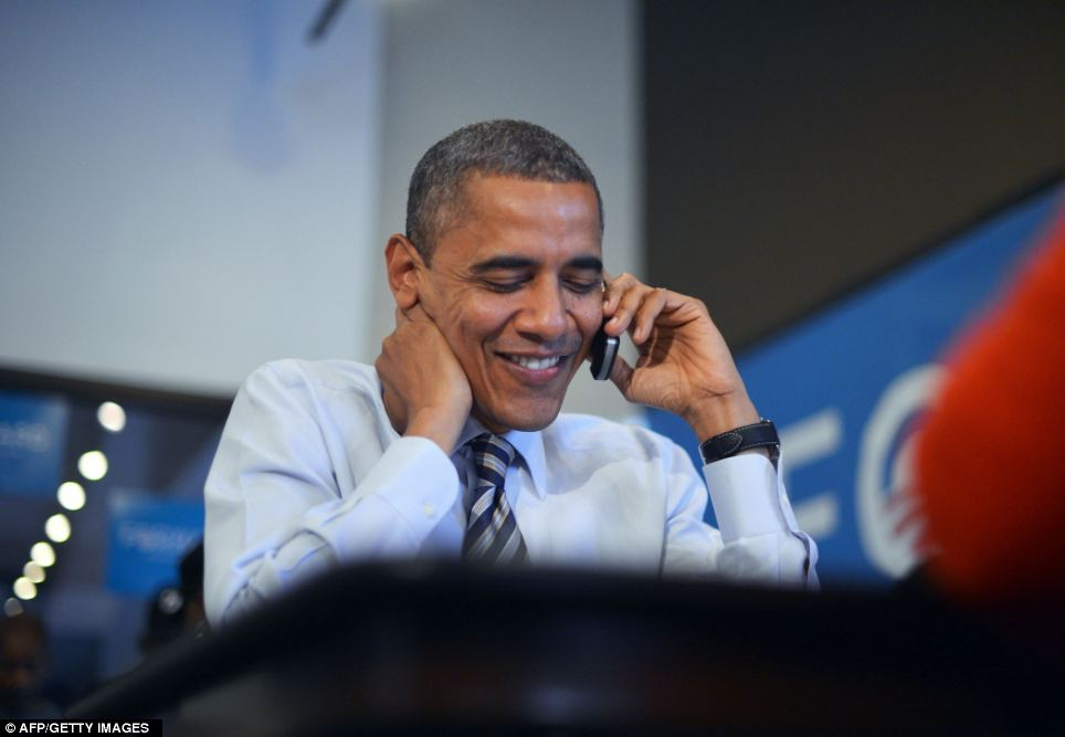 Positive: President Barack Obama calls volunteers in Wisconsin as he visits a campaign office in Chicago, Illinois, on election day