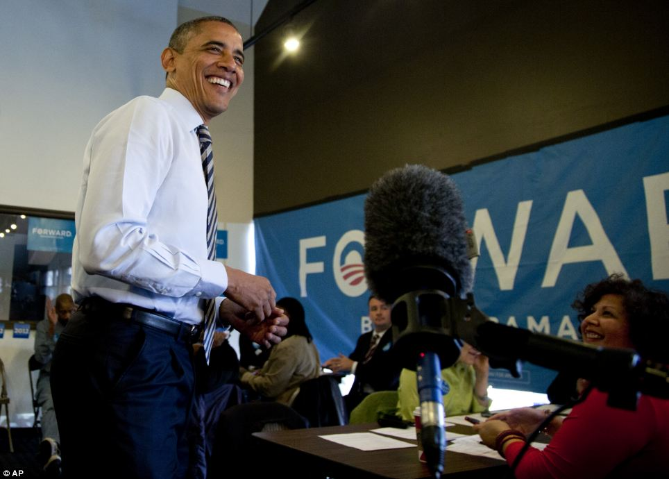 All smiles: President Obama speaks to the media and reveals he is 'confident' that he has enough votes to win the election