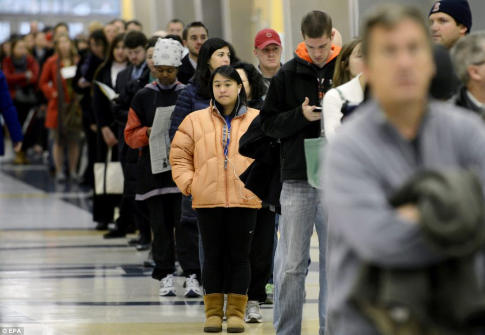 Long wait: People wait in a line to vote in the presidential election at a polling site in Arlington, Virginia on Tuesday morning