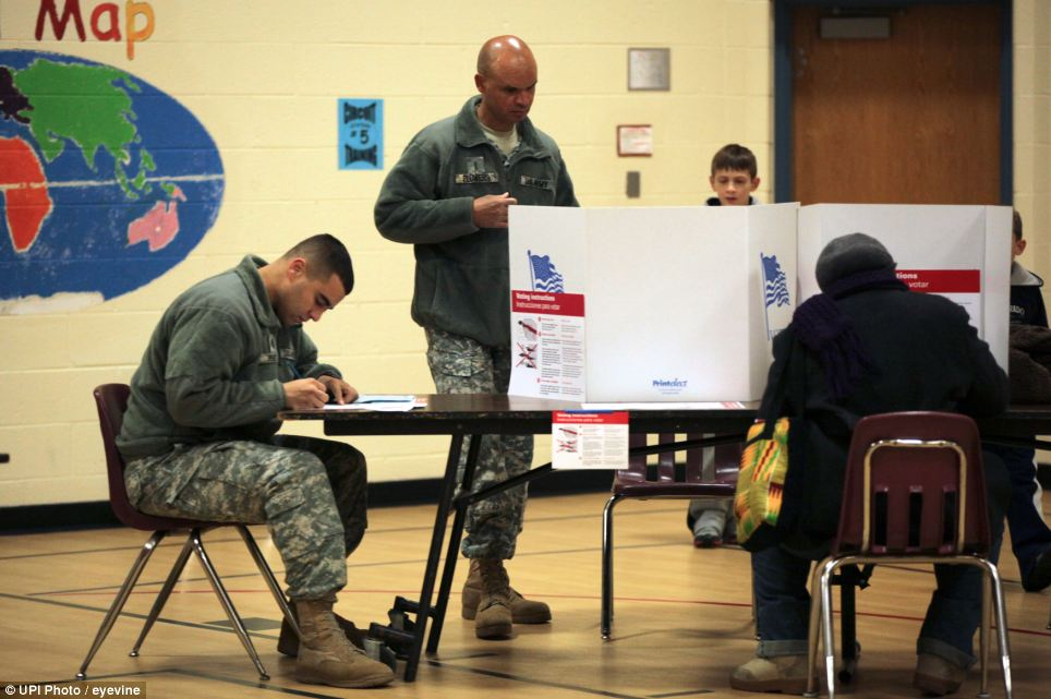 Dedicated: Voters fill out their ballots at Washington Mill Elementary School in Fairfax County, Virginia