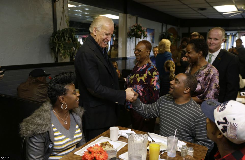 At ease: Customers laugh and chat with Biden as he tours the Landmark Restaurant in Cleveland. He arrived in the city minutes after Romney
