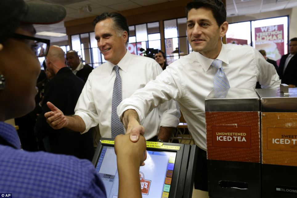 Last efforts: Romney and Ryan grip workers' hands as they make an unscheduled stop at a Wendy's restaurant in Richmond Heights, Ohio