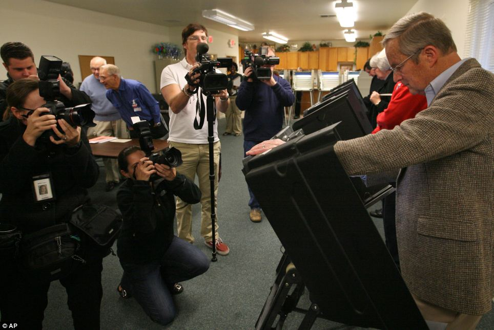 Crowd: The media watches as Congressman Todd Akin vote at the Star Bridge Christian Center in Wildwood, Missouri, where he is running for U.S. Senate