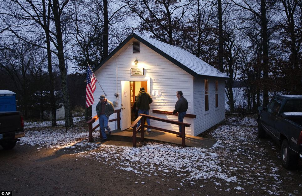 Keen: A light wet snow covers the roof and ground around the Jenkins Town Hall as early voters casts their ballots in Jenkins, Minnesota
