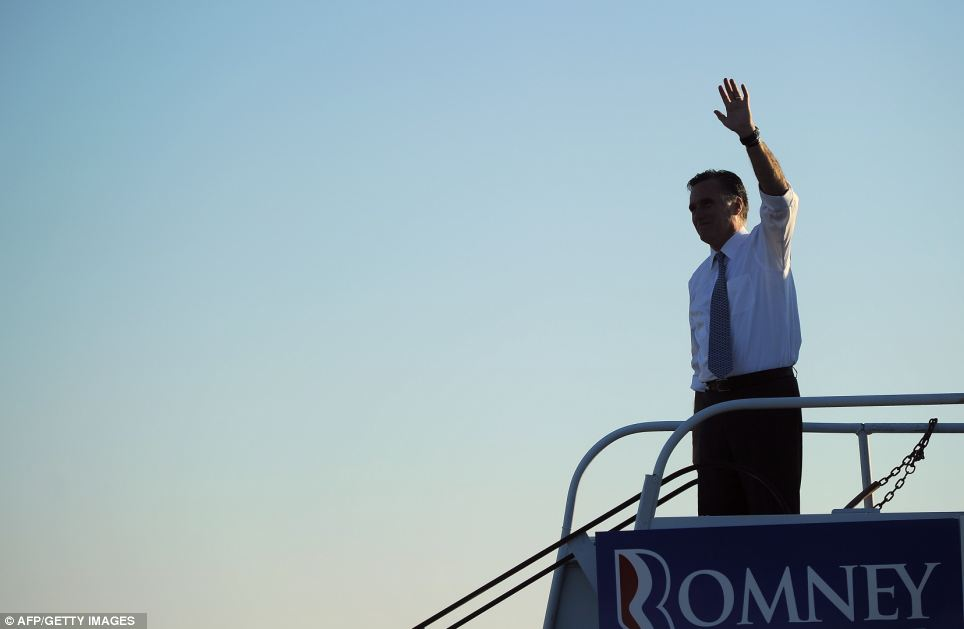 Last hope: Romney waves to supporters while boarding his campaign plane at Pittsburgh international airport in Coraopolis, Pennsylvania