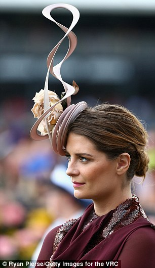 A head for hats: Mischa showed off her style credentials in an unusual floral and swirl detail fascinator