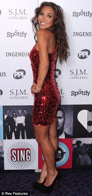 Strike a pose: The former pop star wore a red sequinned monostrap dress with plain black heels