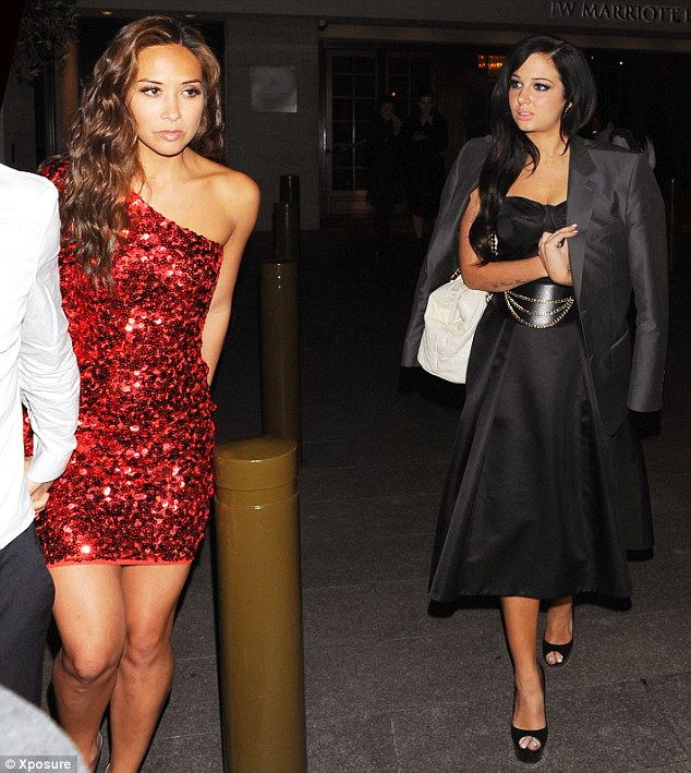 Little red riding hood: Tulisa had to wear a friend's blazer upon leaving the awards show as the cold got the better of her