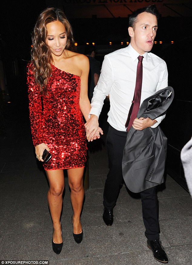 Picture perfect: Myleene was armed only with her mobile phone as she left the party
