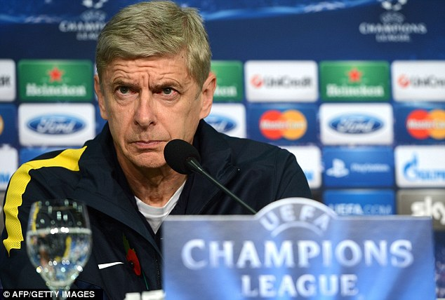 Target: Arsenal manager Arsene Wenger was also subjected to abuse at Old Trafford