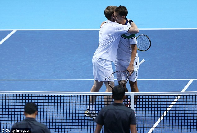 Back on form:  Jonathan Marray (left) and Frederik Nielsen celebrate their victory at London's O2