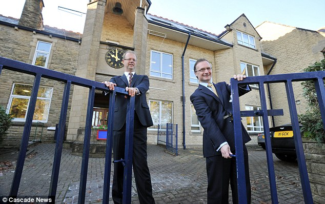 Open to all: Head at QEGS Simon Corns (right) and Chairman of Governors Jeremy Gorik say they must ditch the £10,000 annual fees because it is unaffordable