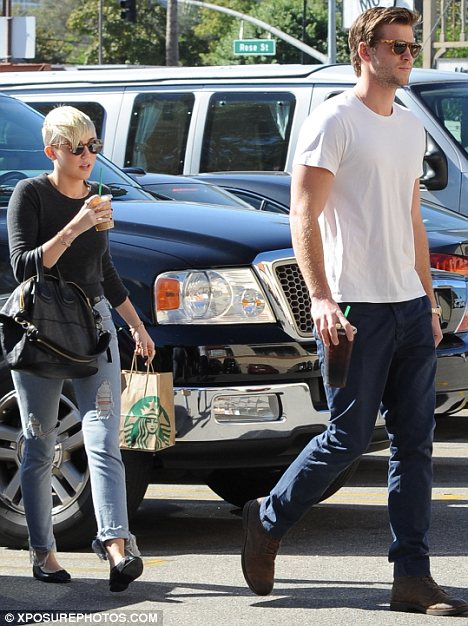 Pick-me-up: The engaged couple were seen on a coffee run together on October 24, the day before the alleged incident took place