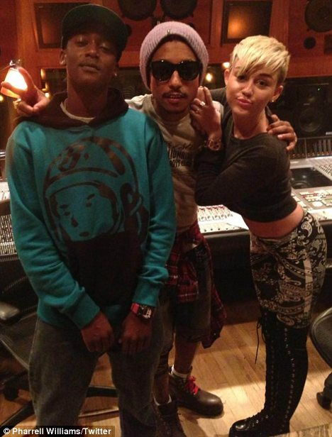 Hard at work: While Liam was at the Samsung Galaxy party, Miley was in  the recording studio with Pharrell Williams