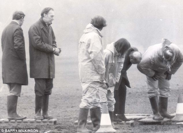 Police and forensic experts, seen examining the place where another victim was killed by the Yorkshire Ripper