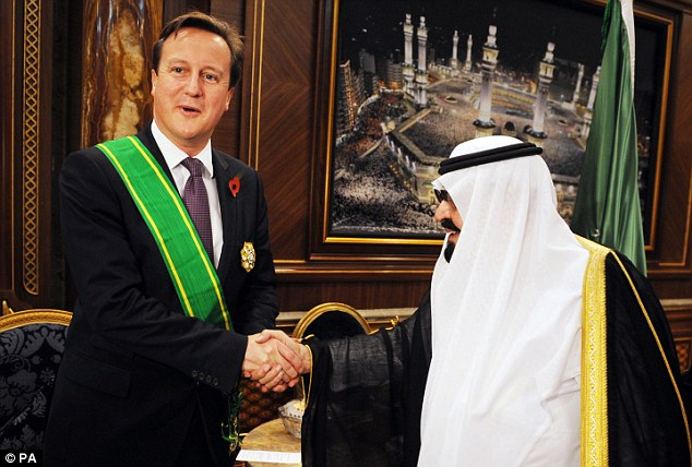 It's an honour: Mr Cameron receives the King Abdullah Decoration One from King Abdullah of Saudi Arabia