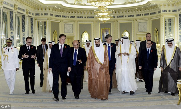Walking: Mr Cameron (fifth left), talks with with President of the UAE, Sheikh Khalifa bin Zayed at al Nahyan (fifth right) at Al Rawda Palace in the city of al Ain in Abu Dhabi, United Arab Emirates, on Tuesday