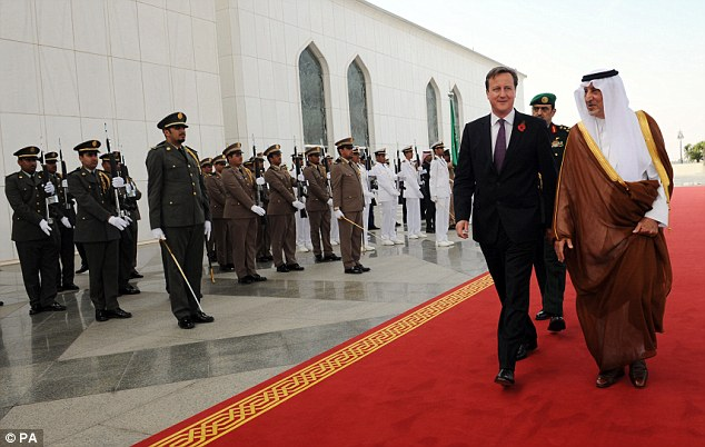 Entrance: Mr Cameron speaks to the Governor of Mecca, Khalid al Faisal, as he arrives in Jeddah on Tuesday