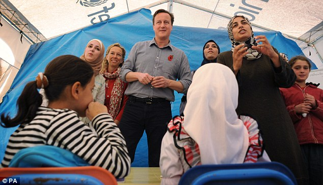 Lesson time: Mr Cameron meets children and teachers in a classroom at the Za'atri refugee camp near the Syrian - Jordanian border where he met Syrian families who have escaped across the border
