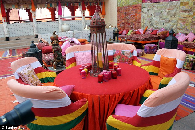 Colours galore: The tables and chairs fitted with the vibrant theme while candles sat ready to light up the evening setting