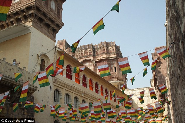 Going all out: Flags adorned the buildings surrounding the party as she put the final preparations in place