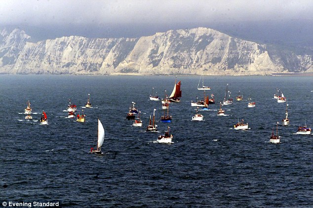 Iconic: The chalk cliffs have stood over dramatic moments in English history, including the return of British forces rescued from Dunkirk in the Second World War, here being re-enacted for the 60th anniversary in 2000