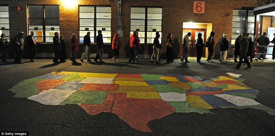 Taking part: Voters queue up at Washington Mill Elementary School in Alexandria, Virginia