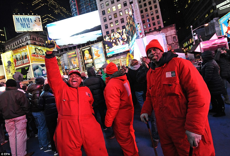 Team effort: Workers celebrate after TV networks announce President Barack Obama won re-election in Times Square, Manhattan, New York